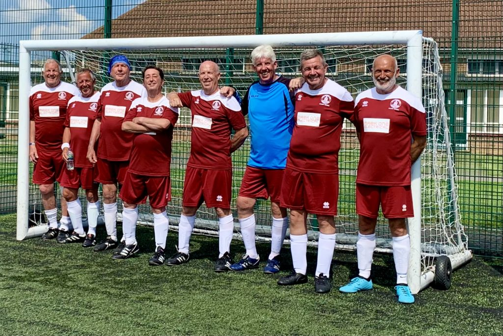A group of football players posing for a photo  Description automatically generated with medium confidence
